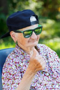 Senior woman wearing sunglasses and baseball cap